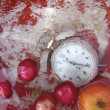 White alarm clock in a water with apples — Stock Photo