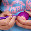 Painting easter egg with pen — Stock Photo