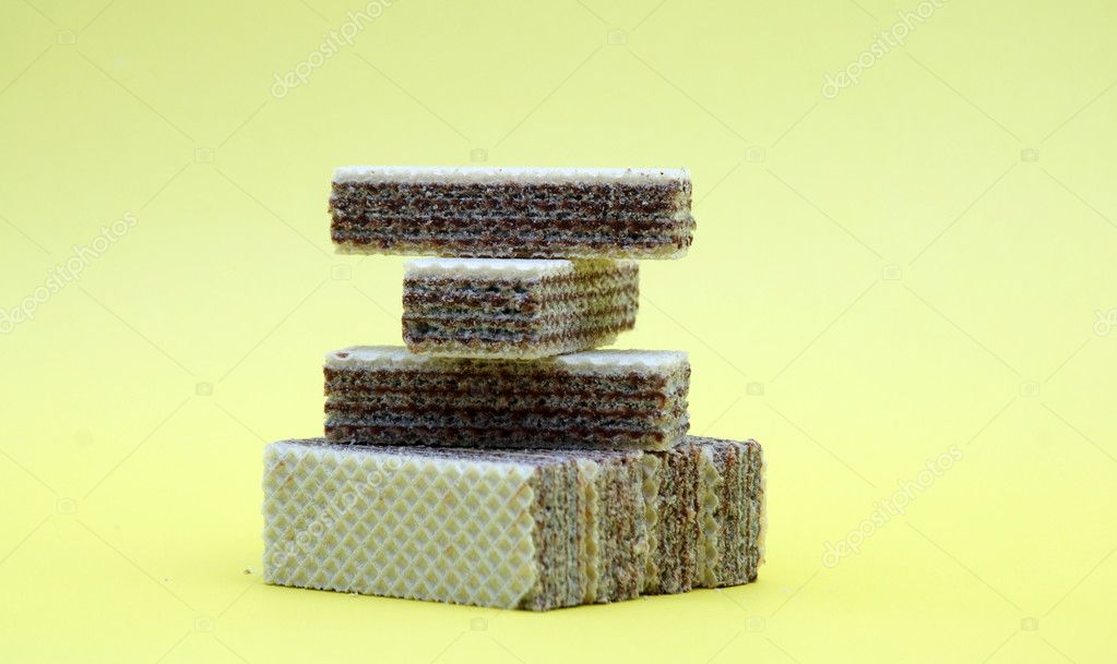 Fresh wafers on a yellow back — Stock Photo #9903590