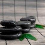 Black stone with leaf. massage stones — Stock Photo #8607333