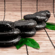 Zen stones and leaves with water drops.  leaf and basalt stones - Stock Photo