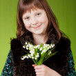 Stock Photo: Young happy girl. little girl on gray background. Happy chil