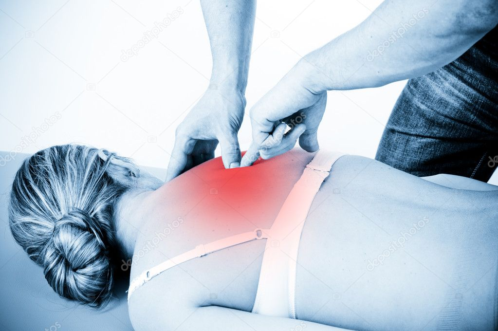 Massage therapist giving a massage. female receiving professional massage. pain concept. — Stock Photo #9742663