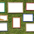Wooden photo frames on spring lawn — Stock Photo