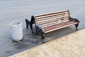 A bench to rest in a public city park — Stock Photo