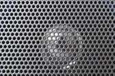 Spherical silver speaker grille — Stock Photo
