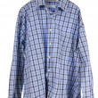 Wrinkled plaid shirt hanging on hanger — Stock Photo #9122927