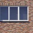 White plastic window and red brick wall — Stock Photo #9123583