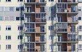 Windows of a multiroom apartment house — Stock Photo