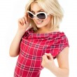 Young blonde in tartan dress — Stock Photo