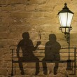 Two silhouettes on a bench — Stock Photo #9599204