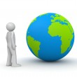 Man looking at planet Earth - globe — Stock Photo #9599383