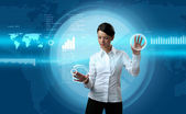 Attractive brunette navigating futuristic interface — Stock Photo