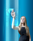 Amazing blonde with interface in the future (outstanding business in interiors interfaces series) — Stock Photo