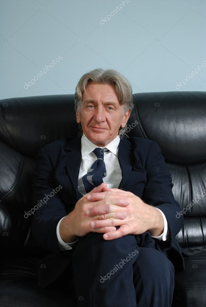 Director on sofa. Attractive seniors studio shots  Stock Photo #9599362