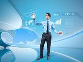Joven empresario navegando por interfaz de realidad virtual holográfica en interiores con estilo. colección futura. uno de una serie. — Foto de Stock