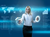 Attractive blonde navigating futuristic interface — Stock Photo