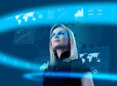 Attractive blonde young woman in futuristic interface — Stock Photo