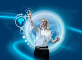 Future Globe Interface Navigating By Attractive Blonde (outstanding business in interiors - interfaces series) — Stock Photo