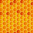 Seamless pattern of honeycomb — Stock Vector