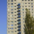 Stock Photo: Tree and tower block in Poznan