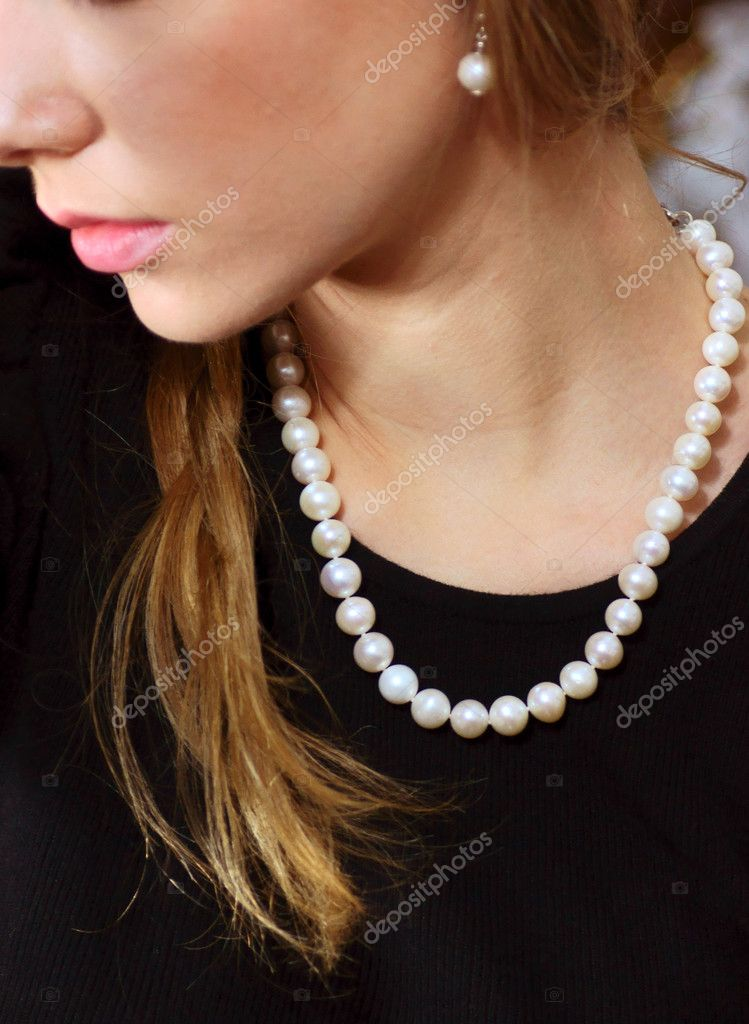 Young, blond girl with pearl necklace  Stock Photo #8282181
