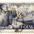 Stamp printed in Poland shows dockworker and ship in port, — Foto de Stock