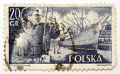 Stamp printed in Poland shows dockworker and ship in port, — Stock Photo