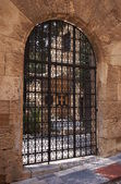 Medieval gate with grid in Rhodes — Stock Photo