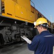 Stock Photo: Train engineer with yellow hardhat