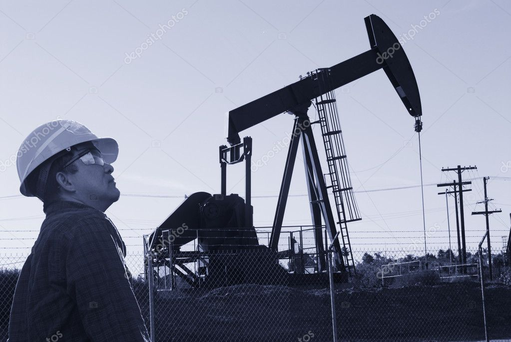 Oil worker on oil field  Stock Photo #7974617