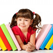 Stock Photo: Happy little girl with books on the floor