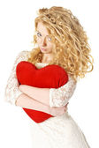 Attractive young woman holding heart — Stock Photo
