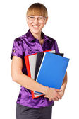 Successful businesswoman holding a folders and smiling — Stock Photo