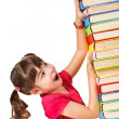 Schoolgirl with the falling pile of books — Stock Photo