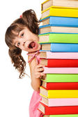 Happy little schoolgirl with a stack of books — Stock Photo