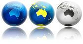 Three different colors globe variations Australia — Stock Photo