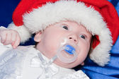 Baby wearing a red and white Christmas Santa hat — Stock Photo