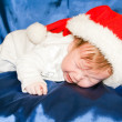 Stock Photo: Baby wearing a red and white Christmas Santa hat