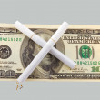 Two cigarettes crossed over one hundred dollar bill — Stock Photo #8607156