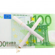 Two cigarettes crossed over one hundred euro bill — Stock Photo