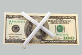 Two cigarettes crossed over one hundred dollar bill — Stock Photo