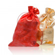 Foto Stock: Red and golden sacks over white