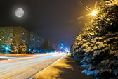 Night snowy road in the small town — Stock Photo