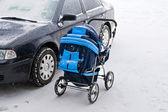 Car and baby's pram on parking — Stockfoto