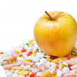 Apple and pills on white background — Stock Photo