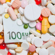 Lot of pills and one hundred euro banknote — Stock Photo