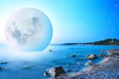 Abstract landscape with moon on sea cost — Stock Photo