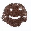 Coffee grains arranged in smiley. — Stock Photo