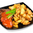 Stock Photo: Grilled meat and fried potatoes on a plate
